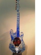 Gitarr med huvud Blå